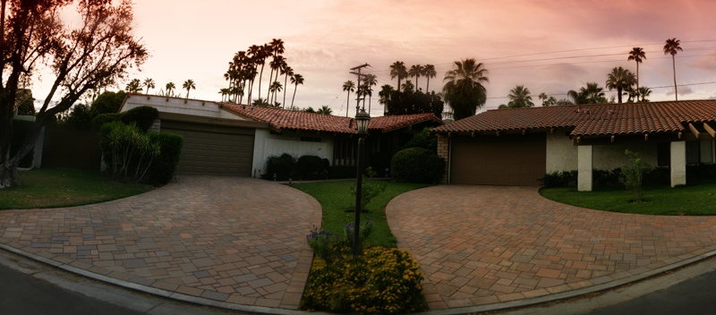 Neighborhood homes after interlocking concrete paver driveway installation.